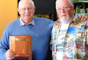 Ken Keeling, winner of the 2 book boxed set 'Miata Mazda MX-5', with auctioneer Bob Judd