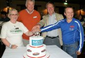 Club Presidents, past and present, cut the cake for our Club's 25th Anniversary